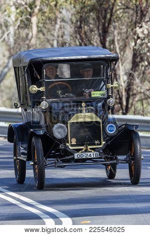 Adelaide, Australia - September 25, 2016: Vintage 1915 Ford Model T Tourer Driving On Country Roads