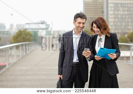 Middle-aged Business Man And Woman Classmates Long Time Ago, Accidentally Met On Street. Male Show F