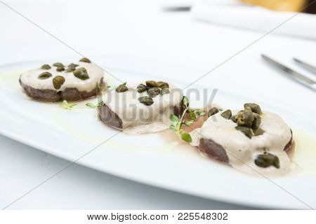 Sliced Veal Covered With A Creamy Tuna-caper Sauce