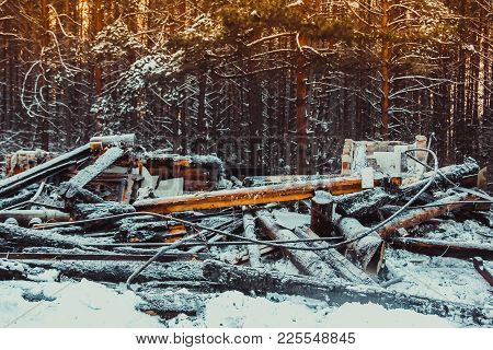 Burned Wooden Walls The House After The Fire. Burnt Old Wooden Building In Russia. Ruined Abandoned