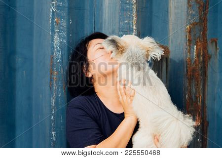 Asian Woman And Dog Happy Hugging With Container