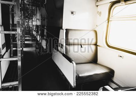 Inside Of Old Public Thai Railway Train Cabin With Seats, Handrails, Fan And Interior In Vintage Sty