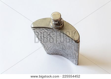 Overhead View Of Old Metal Flask, Top Closed, Drinking Alcoholism Addiction Concept, Isolated On Whi
