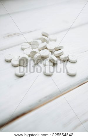 Animal Pet Care. Vitamins Pills For Pets On White Board Background, Close Up, Top View. Pet Care And