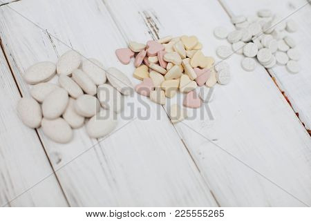 Animal Pet Care. Vitamins Pills For Pets On White Board Background, Closeup. Pet Care And Veterinary