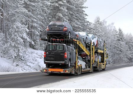 Salo, Finland - January 21, 2018: Scania Car Carrier Of Se Makinen Transports Cars And Vans Along Ru