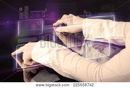 Male hands touching interactive table with purple cloudspace graphic on it