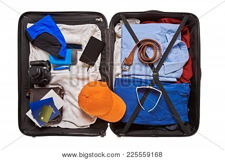 Top View Of Suitcase With Clothes And Accessories For Traveling Abroad