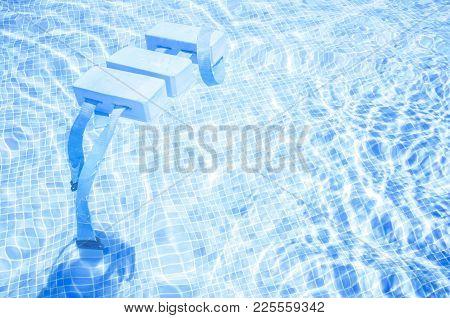 Swimming Float Belt For Kids Swim Training On Swimming Pool Surface. Swiming Pool Bottom Made Of Gre