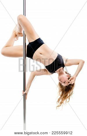 Slender Girl In Black Sportswear On A Pylon On A White Background