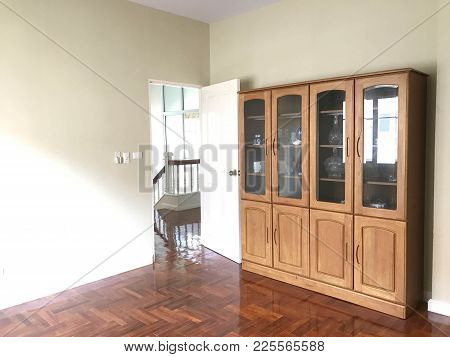 Empty  Opened Room With  Parquet Floor, Green Wallpaper And Wooden Showcase, Angle View