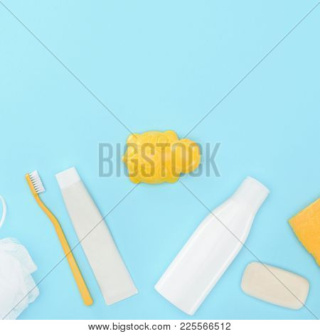 Top View Of Body Lotion, Toothbrush, Toothpaste, Bath Toy And Soap, Isolated On Blue