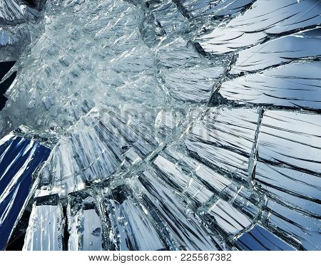 Textured Mirror Background Covered With Small And Large Cracks And Splinters