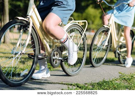 On The Move. Close Up Of A Leg Moving The Pedals While Riding A Bicycle