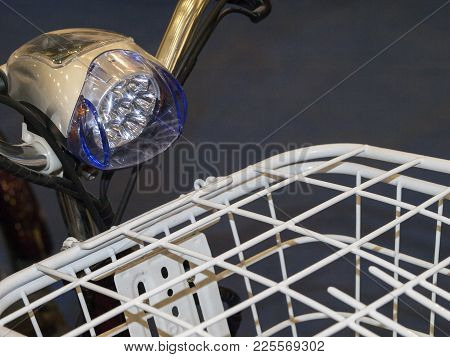 Bicycle Led Headlight Fixed On The Bicycle Handlebar Near The Front Trunk