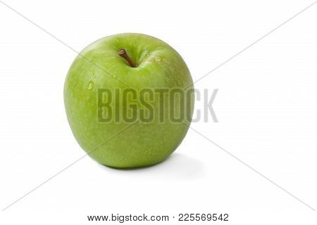 Picture Of Green Apple With Water Drops On The White Background