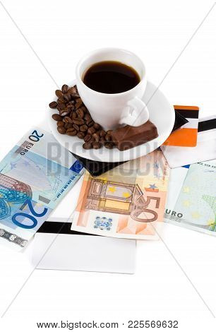 Cup Of Coffee With Money And Plastic Credit Card Isolated On White.