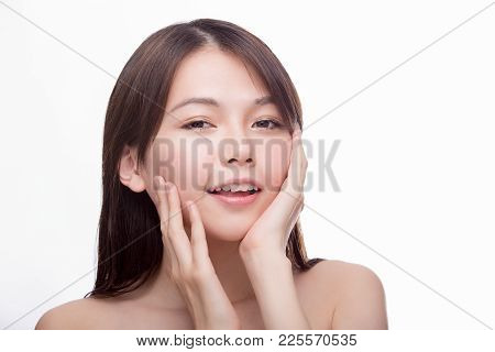 High Key Portrait Of Asian Woman With Hands On Face, Skincare Concept