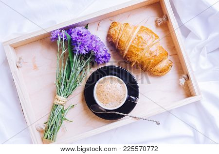 Romantic Summer Breakfast In Bed, Tray With Fresh Croissant, Cup Of Coffee Espresso With Milk And Bo