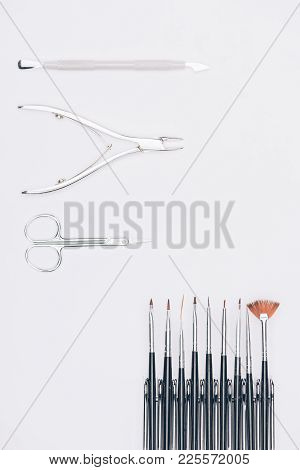 Top View Of Nail Nippers And Brushes Isolated On White
