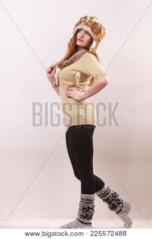 Winter Fashion. Happy Young Woman In Full Length Wearing Fashionable Wintertime Clothes Fur Cap Wool