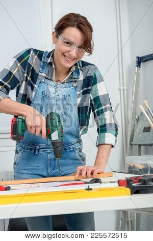 Pretty Young Woman Holding A Cordless Drill