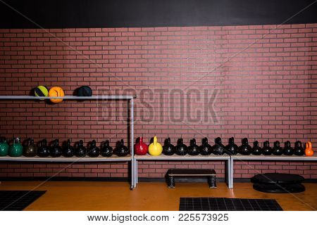 Kettlebells In The Gym On A Brick Wall Background