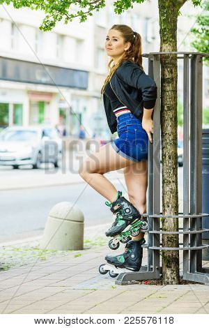 Happy Joyful Young Woman Wearing Roller Skates Riding In Town. Female Being Sporty Having Fun During