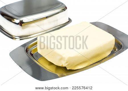 Metallic Form For Creamy Butter. Studio Photo