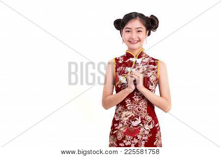 Young Asian Beauty Woman Wearing Cheongsam And Blessing Or Greeting Gesture In Chinese New Year Fest