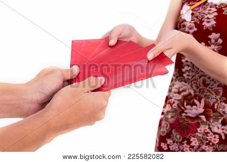 Young Asian Beauty Woman Wearing Cheongsam And Receiving Moneys From Elder Gesture In Chinese New Ye
