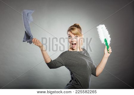 Joy Happiness Chores Cleaning Concept. Cheerful Lady With Household Items. Young Extatic Blonde Maid