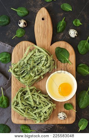 Dry Macaroni Nests With Spinach. Pasta Green On A Dark Background With Spinach Leaves