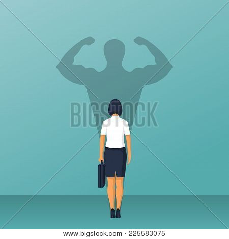 Confident Power. Businesswoman In Suit Standing In Front Wall With Shadow Successful Business Leader
