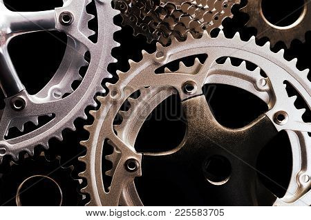 Close-up Of Various Types Of Bicycle Gears On Black Background