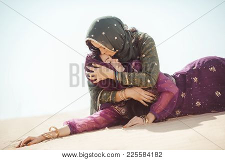 Desert Women Thirsty Dehydrated Lying On Sand Outdoors. Dehydration, Overheating, Thirst And Heat St