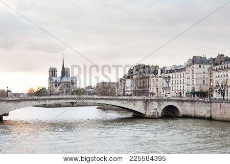 Apartments On Ile Saint Louis, Notre Dame Cathedral On Ile De La Cite And Pont De La Tournelle Over