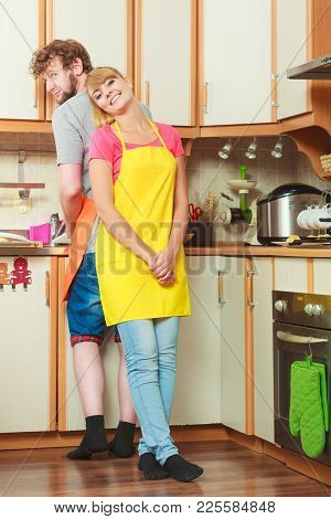 People, Housework And Housekeeping Concept. Couple Doing The Washing Up Together In Kitchen Interior