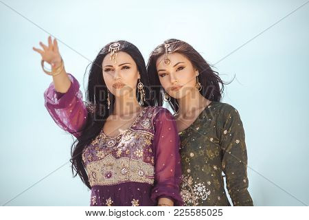 Travel Concept. Adventure Of Two Sisters Princesses Happy Standing In The Desert And Looking At Land