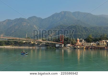 Rishikesh, India - November, 5th, 2017. Beautiful View Of Ganga River Embankment And Ram Jhula Bridg