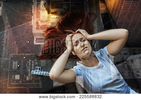 Terrible Pain. Young Tired Woman Feeling Awful And Touching Her Head With Both Hands While Experienc