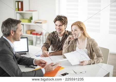 Real-estate Agent Receives A Young Couple Interested To Invest In An House
