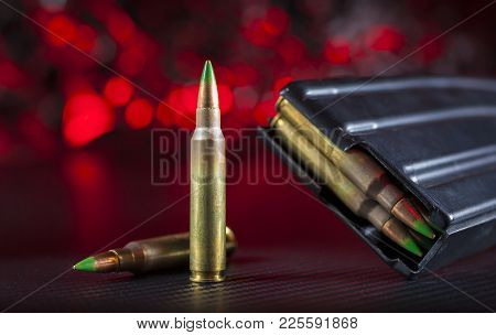 M855 Cartridges And Metal Magazines With Red Background