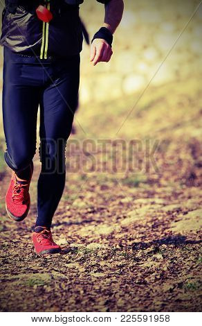 Young Man Runs With Red Shoes Running During A Cross-country Race With Vintage Effect