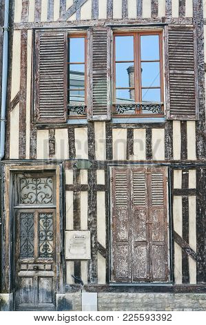 door and windows of the tenement houses in old town of Troyes, France poster