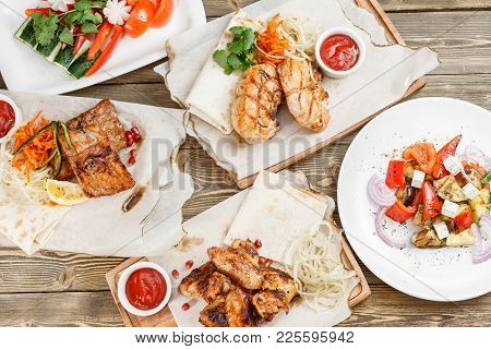 Grilled Chicken Breast. Serving On A Wooden Board On A Rustic Table. Barbecue Restaurant Menu, A Ser