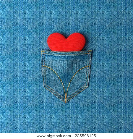 Decorative Background. Jeans Pocket With A Heart Inside On A Jeans Background. Pocket With A Yellow