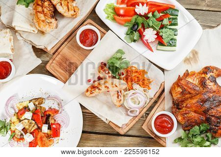 Grilled Sausages And Chicken. Serving On A Wooden Board On A Rustic Table. Barbecue Restaurant Menu,