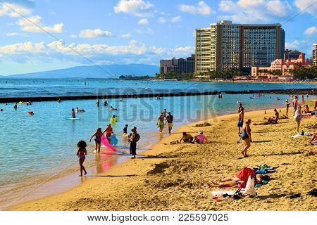 January 28, 2018 At Waikiki Beach In Honolulu, Hi:  Popular Crowded Beach With Highrise Hotels Beyon