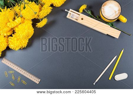 Gray Desk Surface With Color Pencils, Eraser, Ruler, Wooden Pencil Box, Big Cup Of Cappuccino And Bu